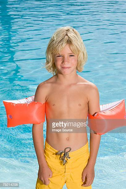 boy wearing armbands - zwembroek stockfoto's en -beelden