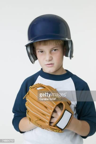 Boy wearing baseball outfit