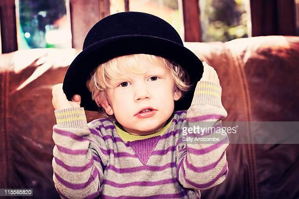 Boy wearing bowler hat