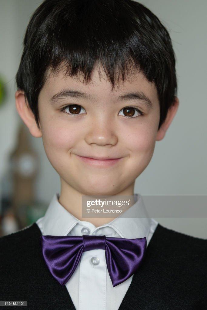 Boy wearing bowtie : Stock Photo