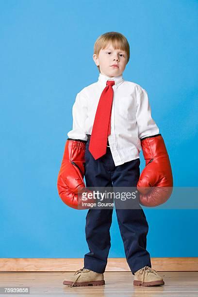 Boy wearing boxing gloves