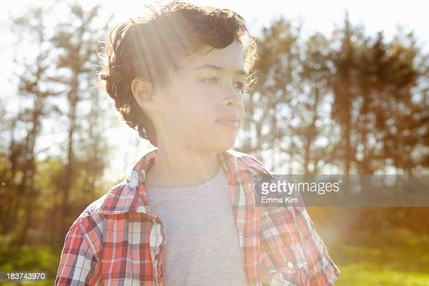 boy wearing checked shirt in park - emma white stockfoto's en -beelden
