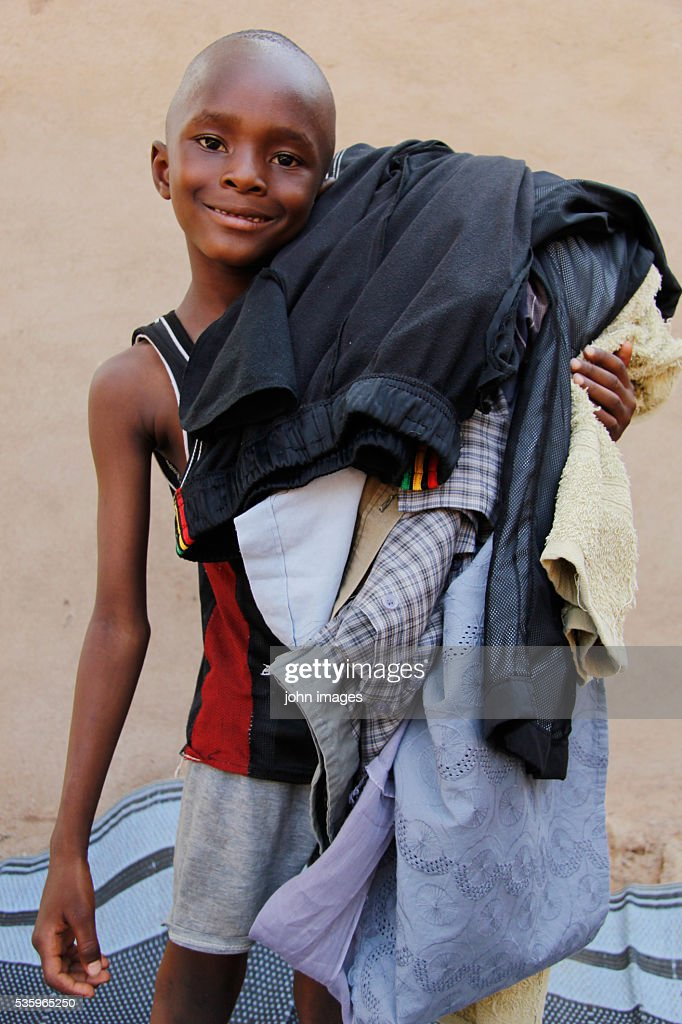 A boy wearing clothes : Stock Photo