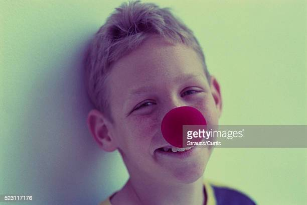 boy wearing clown nose - cross processed stock pictures, royalty-free photos & images