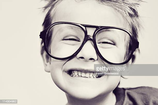 Boy wearing comedy glasses