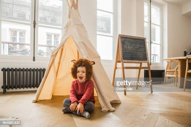 boy wearing costume - teepee stock photos and pictures