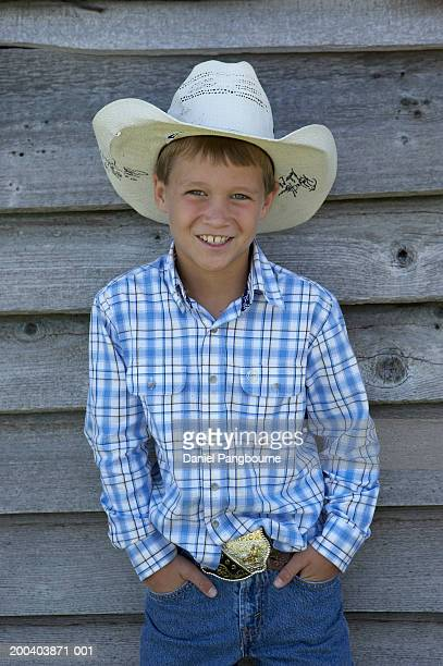 boy (8-10) wearing cowboy hat, smiling, portrait - checked shirt stock photos and pictures