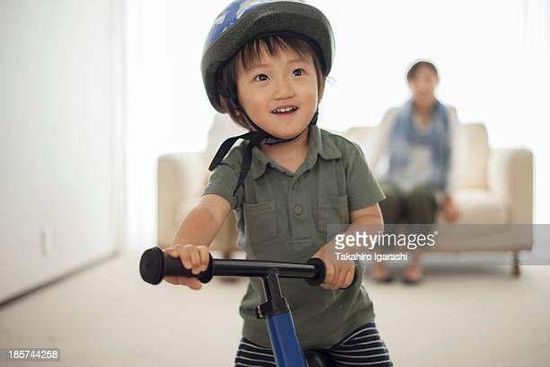 Boy wearing cycling helmet,  portrait