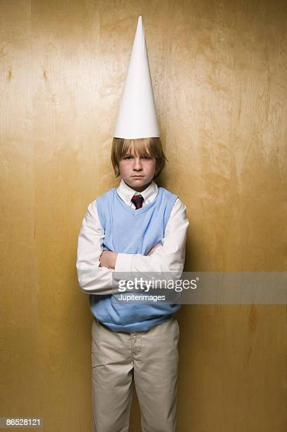 boy wearing dunce cap - dunce's hat stock pictures, royalty-free photos & images