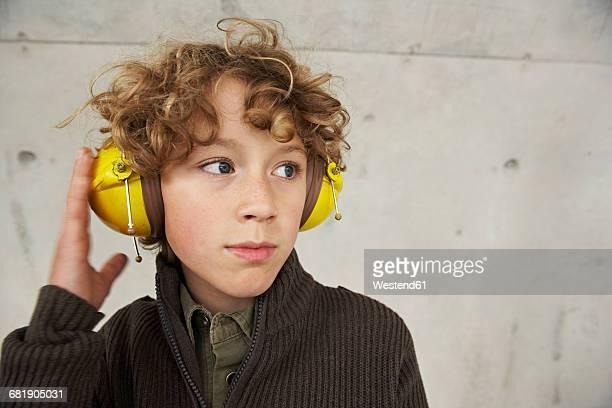 Boy wearing ear protectors, portrait