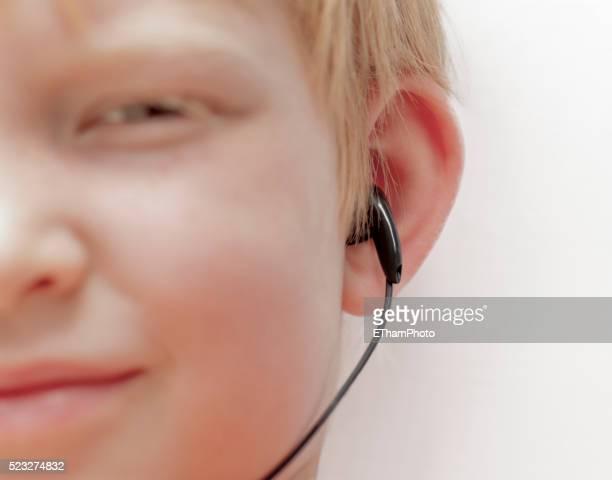Boy wearing earphone