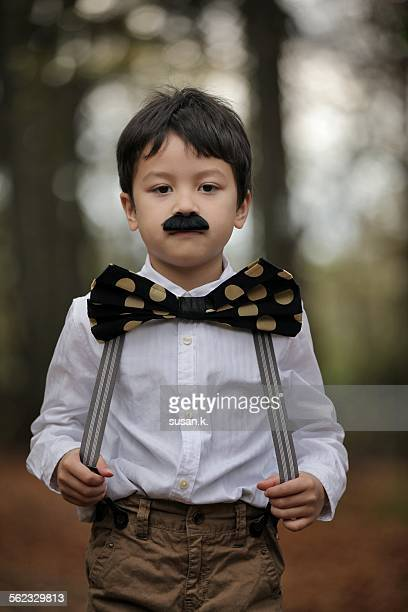 boy wearing fake moustache and - suspenders stock pictures, royalty-free photos & images