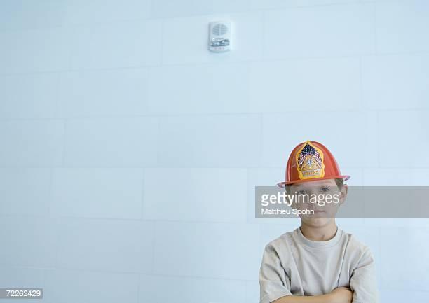 Boy wearing fireman's hat
