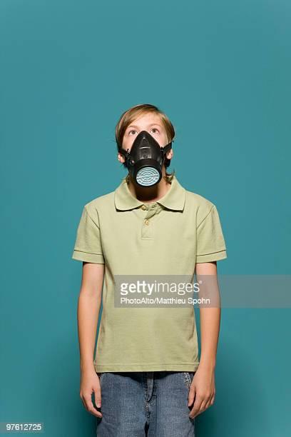 Boy wearing gas mask
