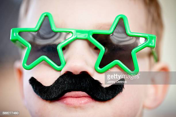 Boy wearing glasses and moustache