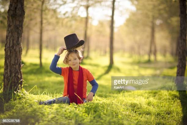 Boy wearing hat in a green park