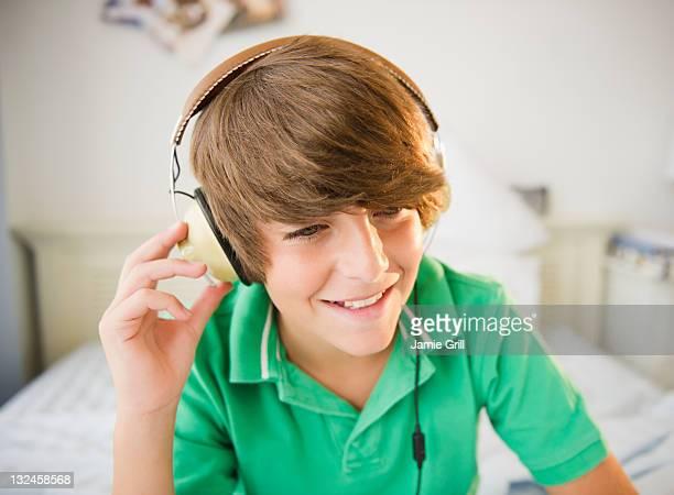 Boy wearing headphones, listening to music
