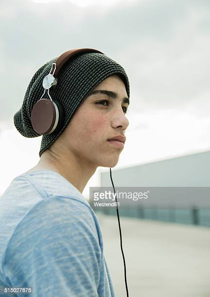 Boy wearing headphones outdoors