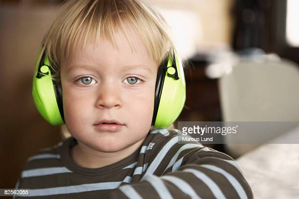 boy wearing headphones, portrait - hearing protection stock pictures, royalty-free photos & images
