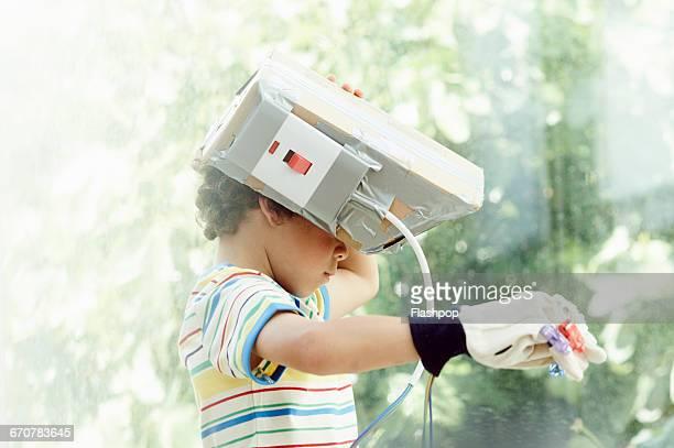 Boy wearing home made virtual reality headset