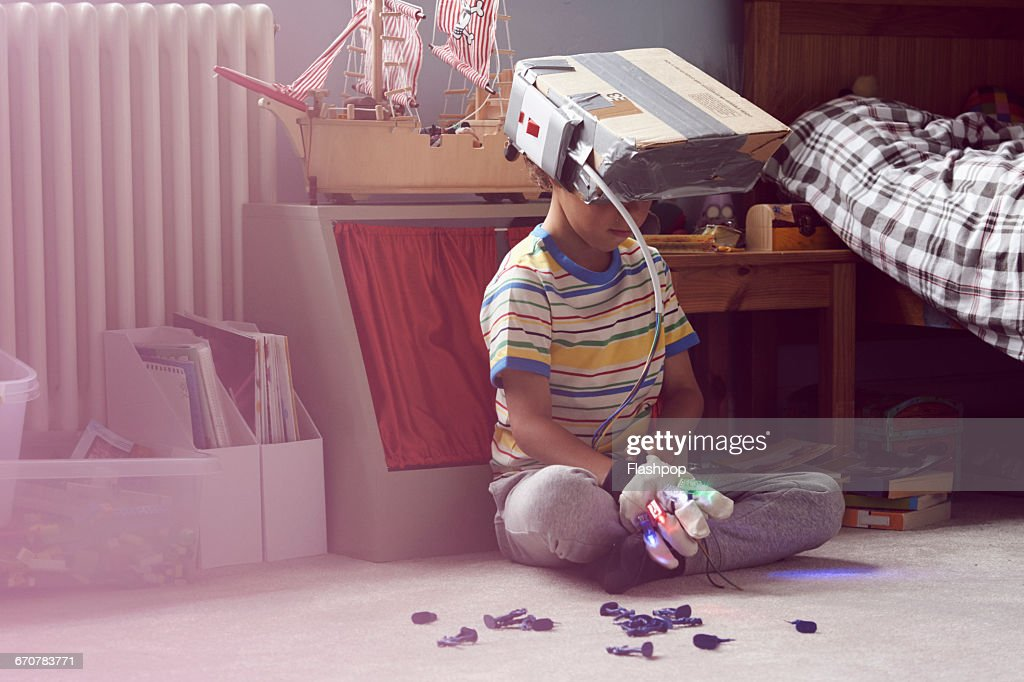 Boy wearing home made virtual reality headset : Stock Photo