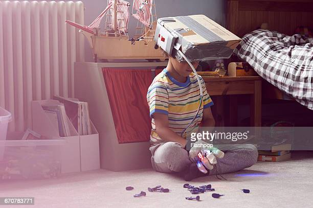 boy wearing home made virtual reality headset - creativity stock-fotos und bilder