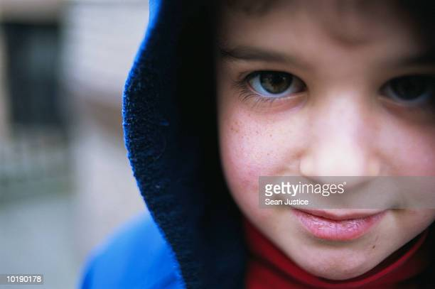 boy (6-8 years) wearing hooded jacket, portrait, close-up - 6 7 years stock pictures, royalty-free photos & images