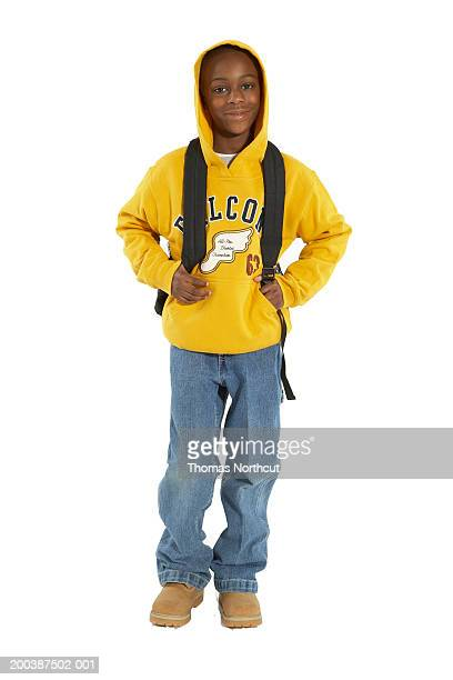 Boy (8-10) wearing hooded sweatshirt, carrying backpack, portrait