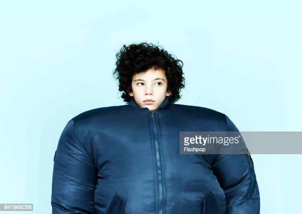 Boy wearing huge bomber jacket