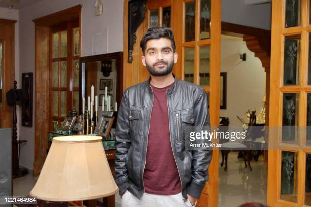 a boy wearing leather jacket in side the house - pakistan stock pictures, royalty-free photos & images