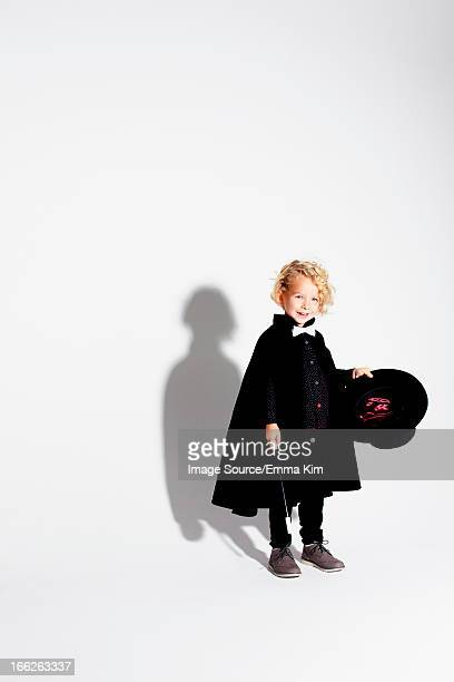 Boy wearing magician costume