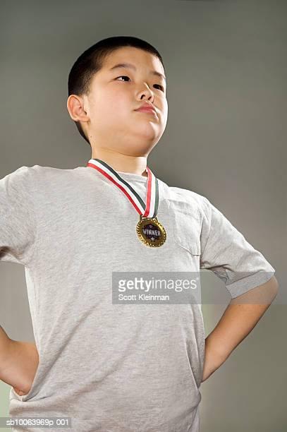 Boy (8-9) wearing medal