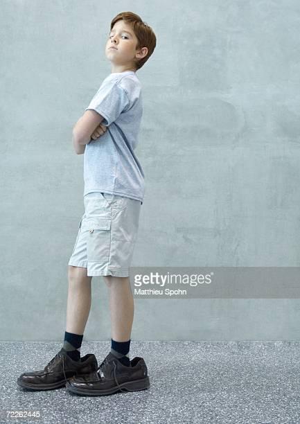 Boy wearing men's shoes