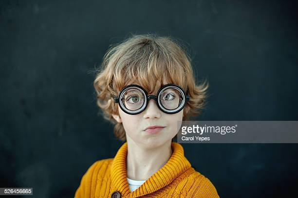 boy wearing novelty glasses - ugly kids stock photos and pictures