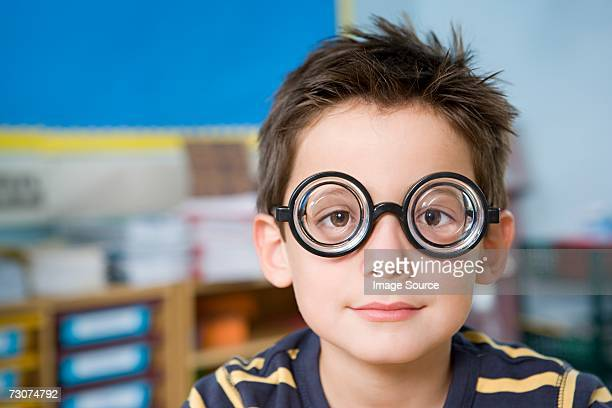 Boy wearing novelty glasses