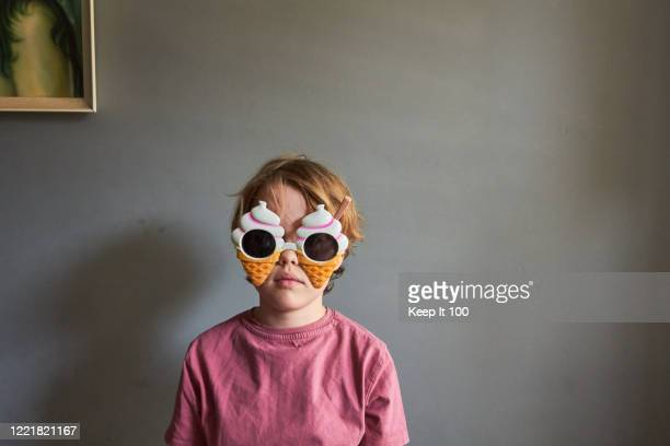 boy wearing novelty sunglasses - children only stock pictures, royalty-free photos & images