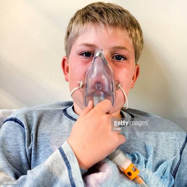 Boy Wearing Oxygen Mask
