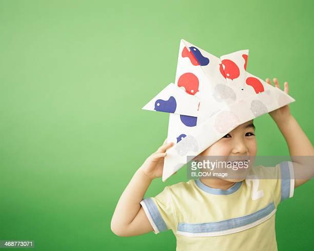 Boy Wearing Paper Hat