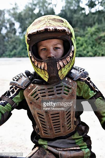 boy (11-13) wearing protective gear, sitting on dirt bike, portrait - protective sportswear stock pictures, royalty-free photos & images