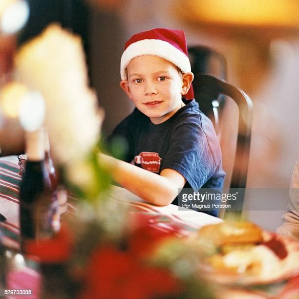 Boy wearing Santa hat, selective focus