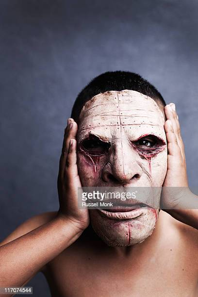 boy wearing scary mask - ugly boys photos stock photos and pictures