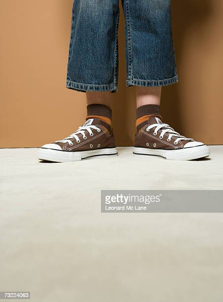 boy (8-9) wearing short jeans, low section - too small stock pictures, royalty-free photos & images