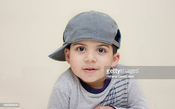 boy wearing side cap - cute pakistani boys stock photos and pictures