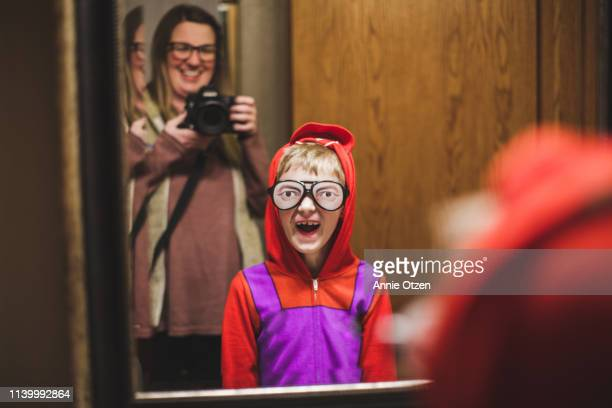 boy wearing silly glasses - naughty america stock pictures, royalty-free photos & images