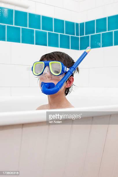 Boy wearing snorkel mask in bath