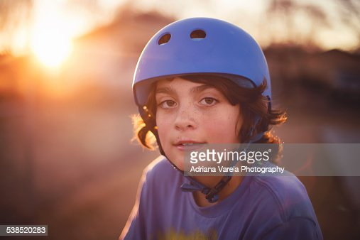 Boy wearing sports helmet