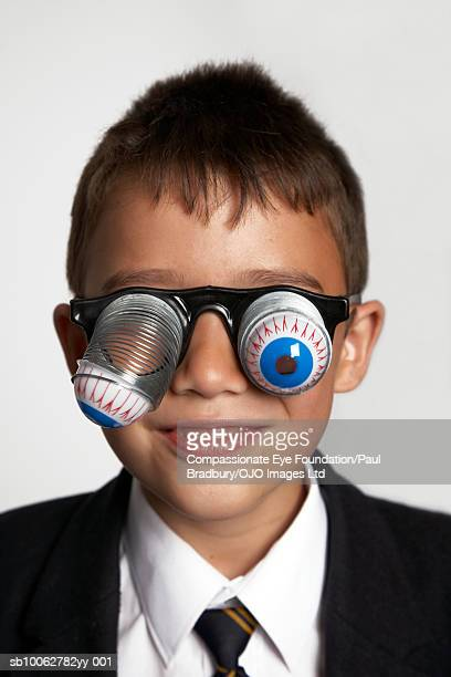 "boy (6-7) wearing suit and novelty glasses - ""compassionate eye"" fotografías e imágenes de stock"
