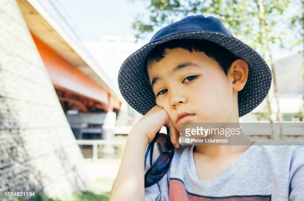 boy wearing sun hat - peter lourenco bildbanksfoton och bilder