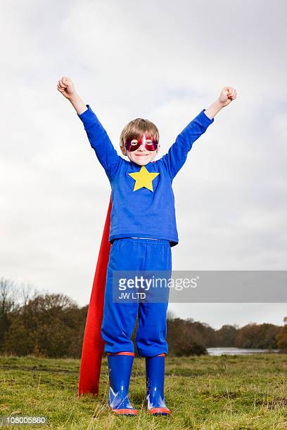 boy wearing super hero costume and eye mask - superhero stock pictures, royalty-free photos & images