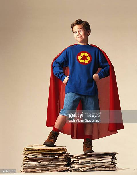 boy (6-8) wearing superhero recycling costume - cape stock pictures, royalty-free photos & images